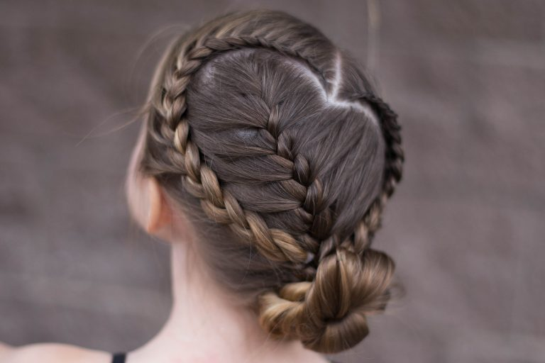 """Back view of girl in front of brown background modeling """"Sweetheart Braid Combo"""" hairstyle"""