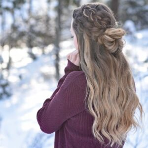 "Back view of girl standing outside in a snowy forest modeling the ""Double Dutch Half-Up"" hairstyle"