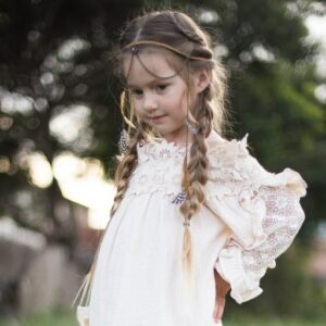 "Young girl with boho inspired head band standing outside modeling ""Boho Side Braids"""