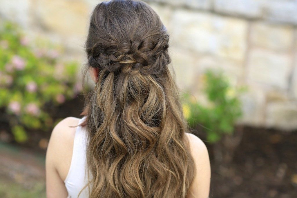 "Back view of girl with long hair standing outside modeling the ""Braided Half Up"" hairstyle"