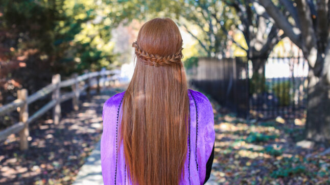 back view of woman with long red hair and back braid