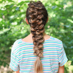 "back view of girl with striped shirt standing outside modeling the ""CGH Wrap Braid"" hairstyle"