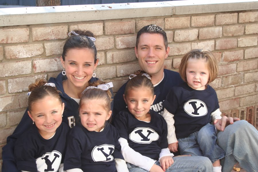 McKnight family before adoption, in BYU clothing