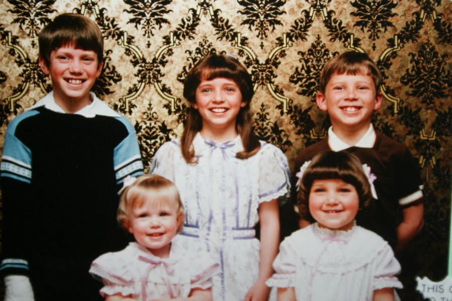 Mindy McKnight, age 5, with her two sisters and two brothers
