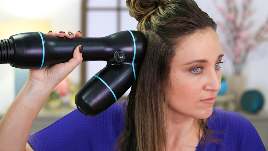 "Woman using hair product, ""RevAir"" to style her hair"