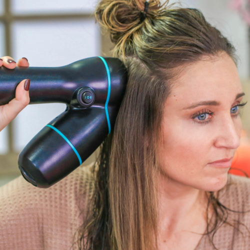 """Woman using hair product, """"RevAir"""" to style her hair"""