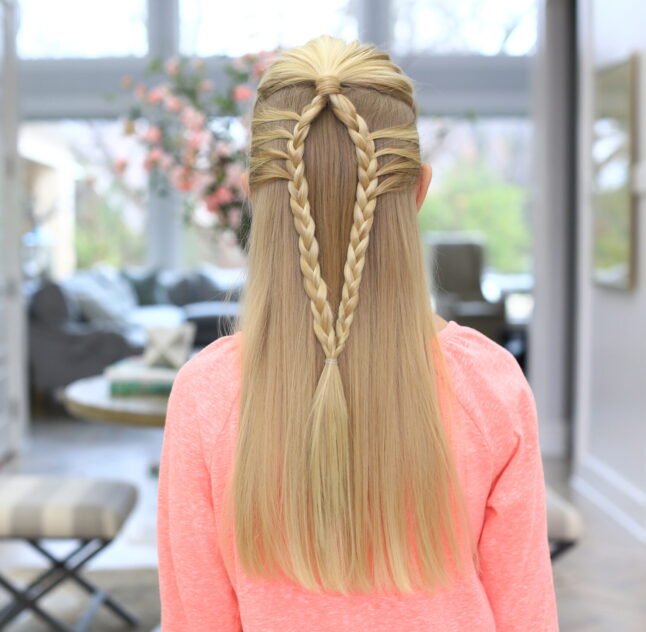 Back view of a girl wearing a pink shirt modeling the Mermaid Loop Braid