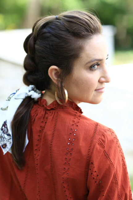 Side View Of Woman Modeling Strand Pull-Thru-Braid