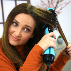 Woman using a blue hairstyling tool
