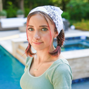 Image of young girl standing by the pool
